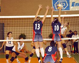 volleyball sports - Volleyball is an Olympic team sport in which two teams of six active players, separated by a high net, each try to score points against one another by grounding a ball on the other team's court under organized rules.[1]