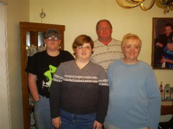 This is a picture of me and my family - I'm very proud of my husband who is a veteran of Desert Storm. He had to serve for six months. One good thing that resulted from that experience is that he got a job with the U.S. Postal Service when he got back home.