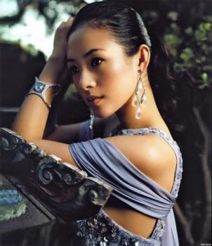 Zhang Ziyi - Waiflike, ethereal and yet somehow a martial arts film favorite, Zhang Ziyi played high-kicking, fist-fighting heroines in Crouching Tiger, Hidden Dragon (2000) and House of Flying Daggers (2003). Zhang was born in China and spent six years at the Beijing Dance Academy before switching to acting studies at the Central Academy of Drama. Her first leading role was in the poetic village romance The Road Home (1999), and one year later she landed a high-profie part as the aristocratic (and acrobatic) young rebel Jen Yu in Ang Lee's hit Crouching Tiger, Hidden Dragon. The role brought Zhang to the attention of international audiences, where her porcelain good looks and steely undertones proved to be a popular combination. The next year she co-starred with Jackie Chan in the action comedy Rush Hour II, and in 2004 she played a mysterious samurai-like courtesan in the art house action film House of Flying Daggers. Zhang and her Crouching Tiger co-star Michelle Yeoh reunited for the Hollywood film Memoirs of a Geisha, due for release in 2005.