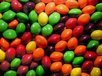 Skittles-a rainbow sweet treat! - Skittles, those fruity, chewy candies that go so well together! Eat just one color, or a handful at once, you're mouth will definitely feel happy!