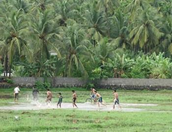 Playing foot ball in rain (Picture from kerala, In - Playing foot ball in rain (Picture from kerala, India)