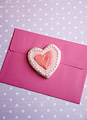 love - photo with valentine heart cookie on envelope
