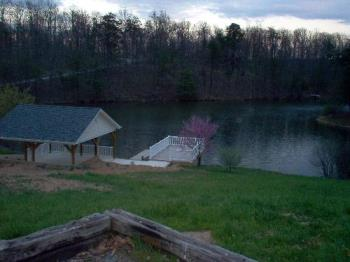 Our Lake and Deck - This is where I do my fishing. I have a chair and table on the deck now so I can cast out, sit down in the chair, and relax. I love it.