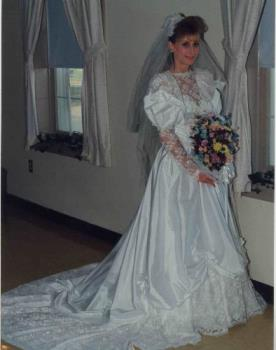 Me in my wedding gown 17 years ago - It's a right pretty gown and bought it on the spot at the bridal store. It looks much more expensive that it is. I paid somewhere around $325. that's it!! But I sure do love it!