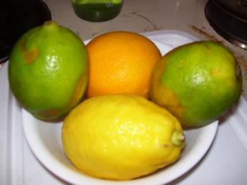 A bowl of citrus fruit - This bowl has two limes one lemon and one orange. I like citrus fruit, it is very refreshing in the summer.
