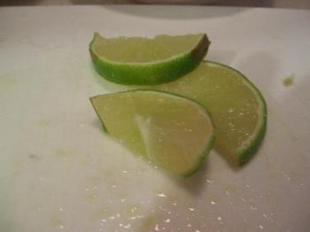 Lime slices - Three slices of lime. They have a green rind and a light green flesh inside. They are tangy, some people use a sweetener and make limeade, some like cherry limeade. I like lime in ice water or tea, as well.