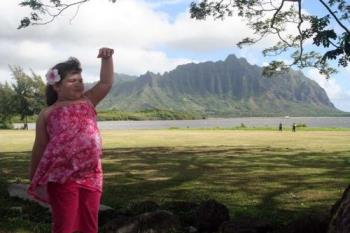 Grand Daughter by the Ocean - This is a photo of my grand daughter on the north shore of Ohau being Hawaniian.