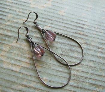 Background ideas - A simple sheet of scrapbooking paper gave this pair of earrings a vintage look.
