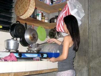 cooking master girl! - stolen shot by my boyfriend. currently cooking dinner for them.