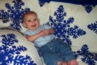 A child on a blanket - A photo of a small child on a blanket.