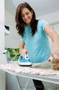 Women Ironing Cloths - She sure looks happy to be ironing. I never looked that happy whenever I had to iron cloths years ago. I am happy that I don't have to do that chore any longer. Thank goodness for small blessings.
