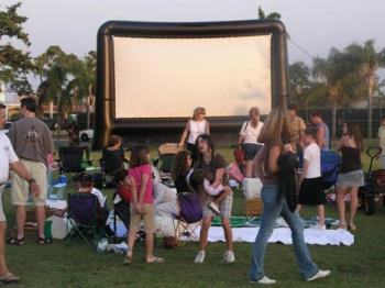 Inflatable Movie Screen - These are cheap and convenient as well.