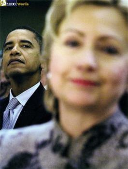 Hillary and Obama - Obama doing what he does naturally. Looking down his nose at people.