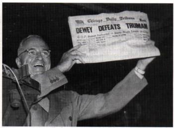 Dewey Defeat Truman - President Truman holds up newspaper proclaiming his opponent the winner