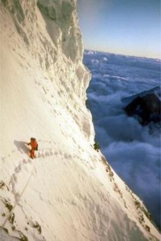 K2 bottleneck - Ed Viesturs and his partner approaching the summit of K2, the second-highest mountain in the world (from sea level), and the second or third most dangerous to climb.