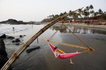 Goa Beaches - Relaxing on one of the Goa's beaches .