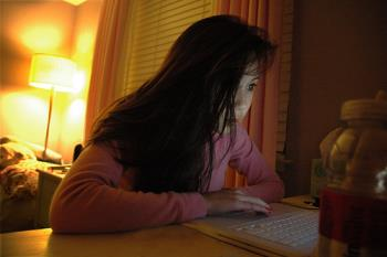 Computer Addict - A snapshot of a woman addicted to computer. She looks like a computer zombie.