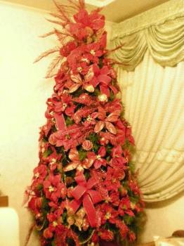 Our Red Tree - Here's a picture of the tree that I mentioned. It's full of ribbons and glittered butterflies and if you'll look at the top it's got a very big bow on it, instead of the traditional angel.