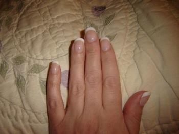Fake Fingernails - Here is my hand with fake Glue-On Fingernails.  Medium Length French Manicure.