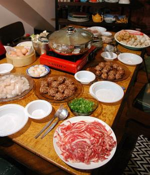 Steamboat - Traditional steamboat dinner with all kinds of ingredients cooked in a rich chicken stock.