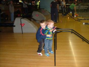 My son on his 8th birthday bowling with his little - My two youngest sons bowling