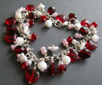 "Be Mine Bracelet - This 7 1/2"" silver plated bracelet is adorned with Czech glass Ruby Red Hearts, and deep red faceted beads, accented by tiny white glass flowers, white cats-eye beads, pearly white with red glass beads & pearly pink E beads.