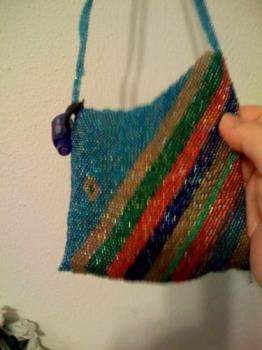 my cell phone bag - i used peyote stitch to make this