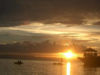 Sunset at Camotes Island - The picture was taken when I went went my family in an island of Cebu. This is the sunset at Mangudlong Beach Resort.