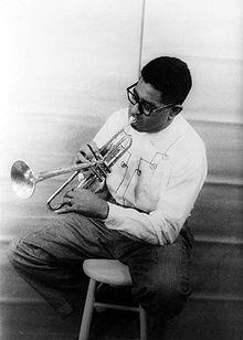 Dizzy playing a Horn - This is a photo of Dizzy Gillespie playing a horn in 1955
