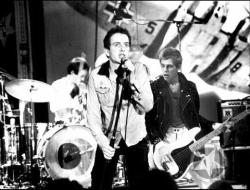 The Clash live on stage - Joe Strummer, Paul simonon, not sure if that's Topper Headon or Terry Chimes (Tory Crimes) on drums, Mick Jones must be just out of shot