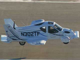 Flying Car - This a photo of what is called a flying car which it really isn't but is a plane that has wings that folds up but can be driven on roads like a car..