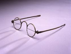 BiFocal Spectacles - The photo shows an old-fashioned bifocal pair of spectacles. It is typically called a 'Franklin-type' spects.