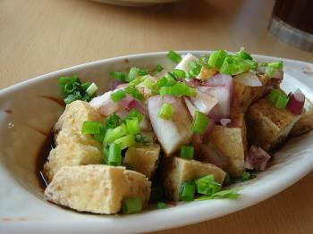 tofu, fried tofu in soy souce, onion and spring on - delicious tofu recipe of all-time.even kids will like