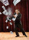 money magic - magician conjuring money out of his hat......with smokie smoky .