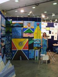 me at the art expo - me and a selection of my paintings at the brisbane art expo.