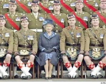 Kilted Scotsmen - Queen seems happy with the man next to her