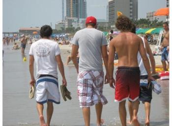 men walking on the beach - a nice walk on the beach