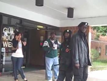 Voter intimidation - Obama's thugs stand in front of a polling place in Philadelphia brandishing nightsticks.