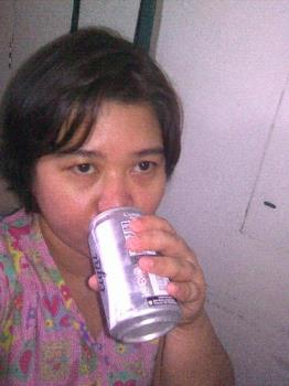 I am drinking Coke - that's me drinking Coke in can