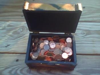 A penny saved is a penny earned !!! - Treasure chest filled with pennies.