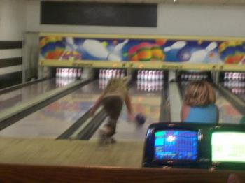 My Daughter Bowling - This picture is a little blurry but it one of my daughter bowling in her youth bowling league.