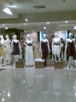 gowns - gowns and dresses on display in a mall