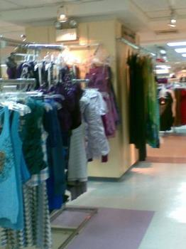 dresses - wide array of dresses on display in a mall
