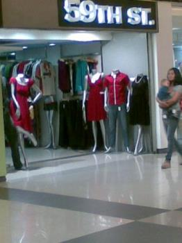 dresses - dresses for special occasions on display in a mall