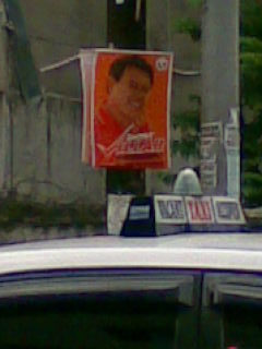 campaign poster - one poster seen on a busy street leading to a big hospital in the city