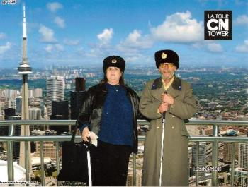 My Husband And I In Our Russian Hats... - ..and he has a Russian coat. This was taken at the CN Tower in Toronto, on December 26th, 2009.