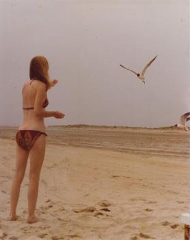 I'm feeding seagulls lemon cookies. - This was taken in the mid-70s when I was quite a bit younger and quite a bit thinner (svelt, as I was fond of saying) and quite a bit more agreeable to wearing a bikini.