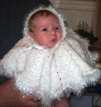 Knitted Poncho - My granddaughter in a knitted poncho I made for her