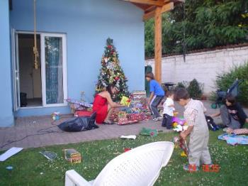 Chistmas in Summer - Grandchildren play while presents and handed down.