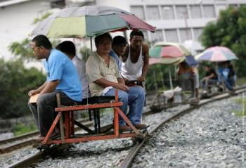 Trolley in the PH - This is a unique form of transport here in PH. Though quite dangerous because they travel thru the train's rail. They will quickly get up and carry this if a train will pass by.
